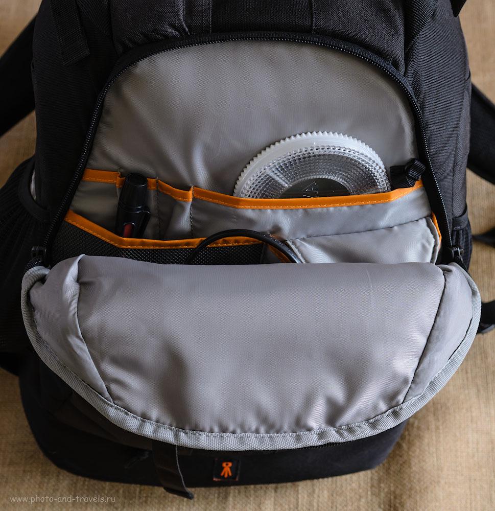 Фотография 11. Наружный карман фоторюкзака Lowepro Flipside 400 AW для хранения мелочи.