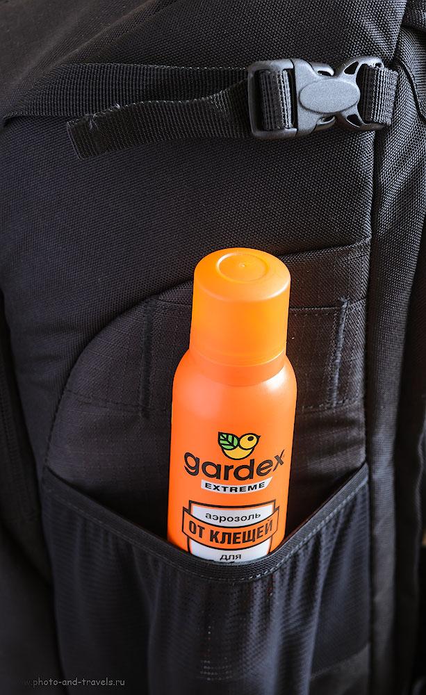 Фото 12. Внешние карманы рюкзака для фотоаппарата Lowepro Flipside 400 AW можно использовать для переноски бутылки с водой или, как в данном случае, средства для отпугивания клещей во время походов по лесам.
