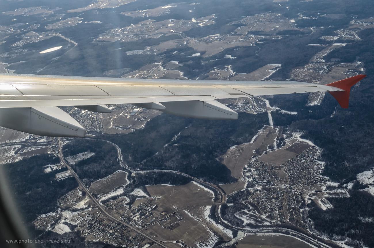 Съемка на Nikon D5100 через иллюминатор самолета.